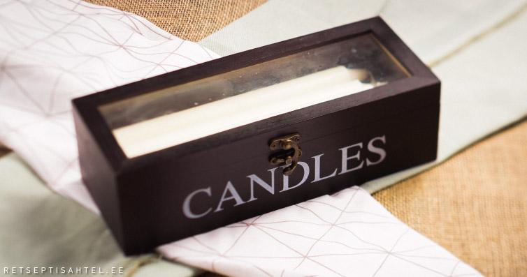 Küünlad ja karp Retseptisahtel